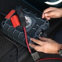 NOCO GXC007 being installed to a NOCO GX industrial charger for golf cart charging