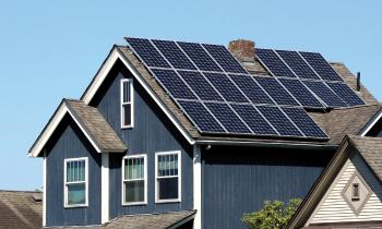 Rooftop photovoltaic solar panels converting sunlight into power.