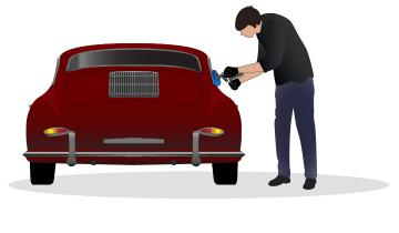 Classic vehicle owner polishing Porsche 356 with a polishing tool in preparation for winter storage.